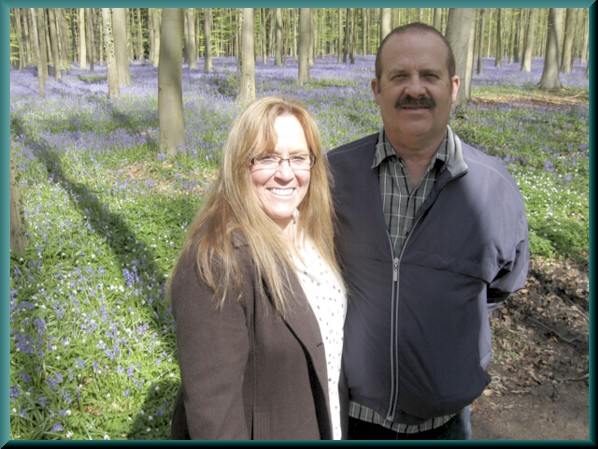 Bob and Stormie James in forest of bluebells, Belgium